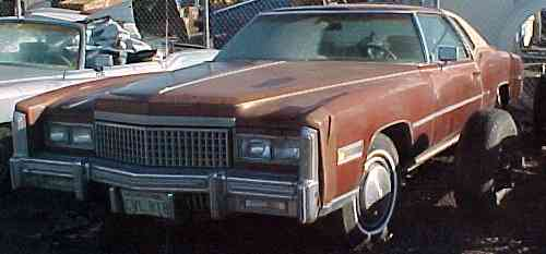 1975 Eldorado Convertible - package deal - Complete, original and running, 500cid, top shot, interior rough, has skirts and extra seats plus complete and running 1975 Eldorado Coupe. $3,200 for both  n-130