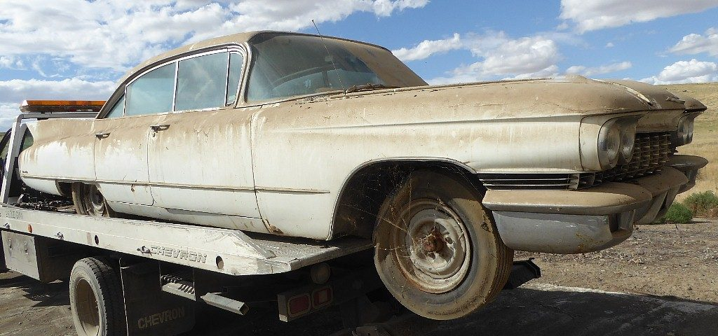1960 Cadillac  Series 62  4 dr H/T, complete and original, stored in a barn since early eighties, minor rust and old body work. Skirts and hubcaps in trunk. Not running  $3,500 n-516 Sorry, this one is sold!