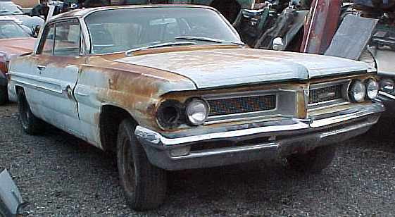 1962 Grand Prix - no motor, no trans, rear end damage, good glass, great parts car. n-040