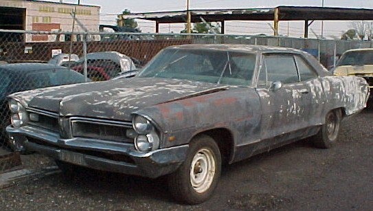 1965 Pontiac Grand Prix, complete less engine and trans, buckets, tilt, reverb, rough but restorable.  n-206
