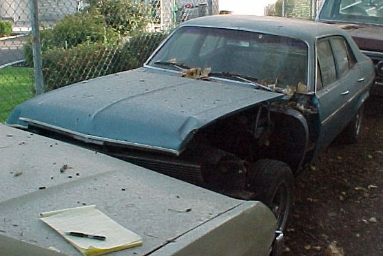 1971 Nova 4 Door 6 cylinder, Turbo 350, power steering. Has front-end damage, otherwise clean. $750. n-222