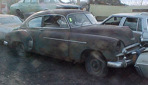 1949 Chev Deluxe 2 dr Fastback, Complete less motor. Rough but very restorable or make a great custom/ lowrider. Has rare accessory hood ornament, grille guard,and trunk guard. $1,850 n-277