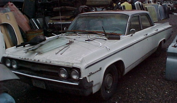1964 Olds Dynamic 88 4 dr sedan, 425 2 barrel, power steering and brakes, straight, not rusty, complete, original and untouched, but engine is seized $1,500  n-289