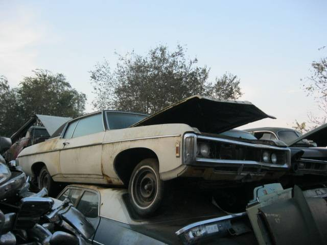 1969 Impala Custom 2 dr Hardtop no engine or trans. has disc brakes, 12 bolt, black interior. Great parts car. n-303