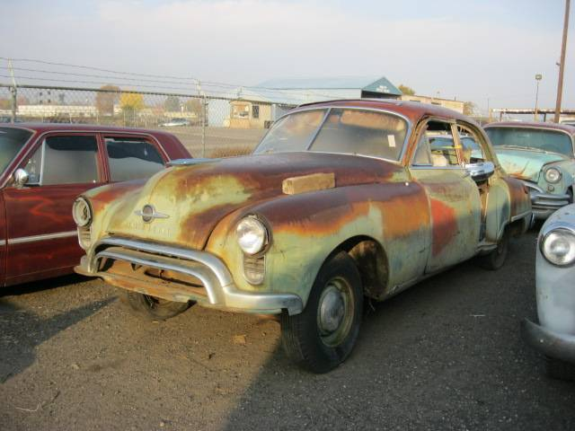 1949 Olds 98 - 4 dr sedan  Complete but partially disassembled. V-8 Automatic nice bumpers and chrome, Great parts car   n-304