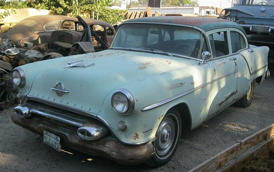 1954 Olds 88 4 dr sedan V8 freshly rebuilt, 4 barrel automatic, runs good, complete but rusty and roof is caved in because we dropped a car on it. $1650 or might part out n-379