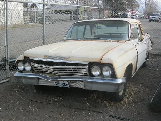1962 Chevrolet Biscayne 2-door post sedan.  6 cyl. 3-speed, one owner, ultra-Plain Jane, runs OK, rear end damage.  $1,800  n-428