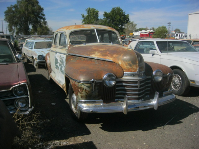 """1941 Olds 4 dr sedan. 6 cyl, 3 speed manual, new 16"""" tires, engine runs, complete and very original.  $2,450   n-443"""