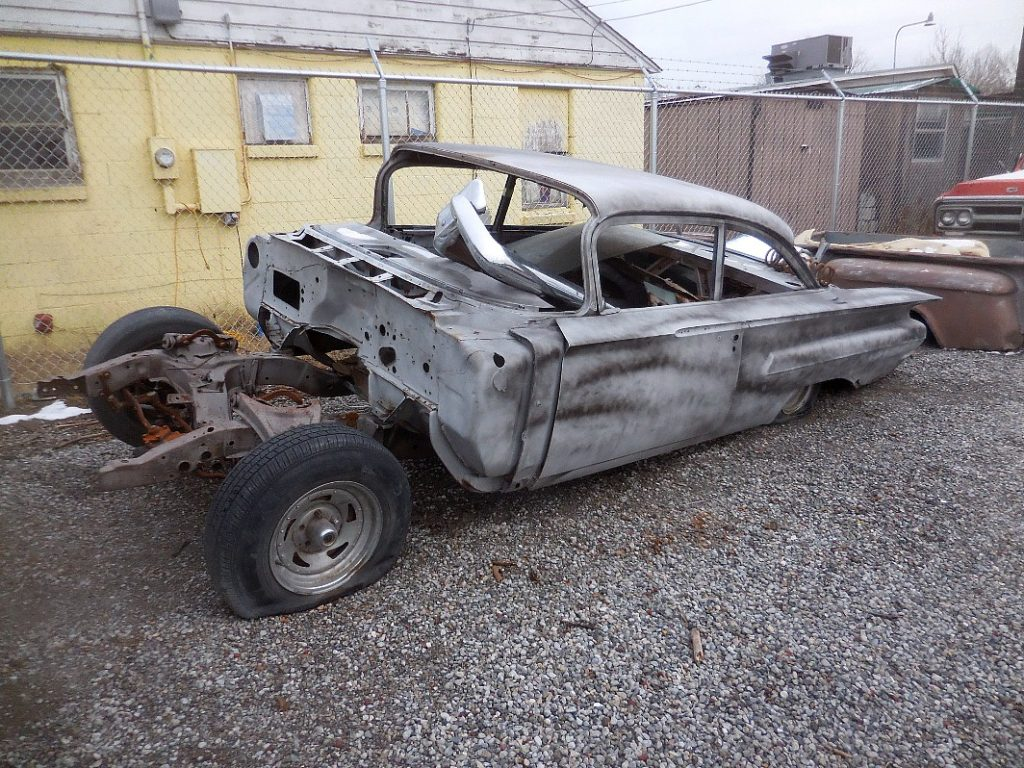 1960 Chevy Belair 2 door sedan, no engine or trans stripped to bare metal and primed. Incomplete but really straight, needs floors and patch panels.  $1,850  n-481
