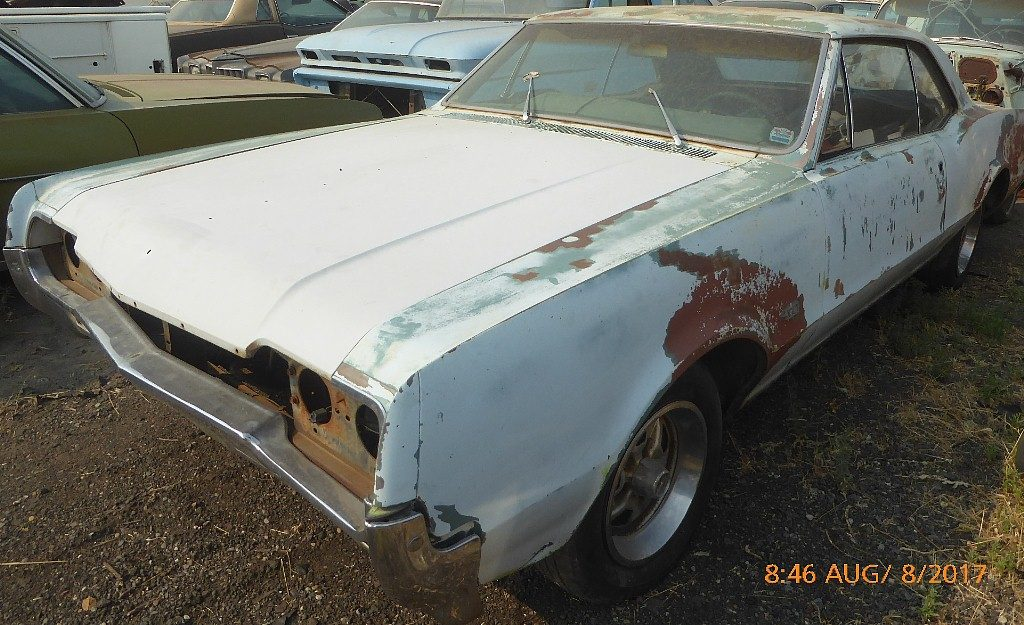 1966 Olds F/85 2 dr H/T  330 V-8, automatic, power steering and brakes, engine disassembled, good straight body 95% complete   $2,250 n-534
