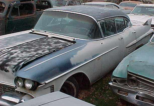 1958 Cadillac 4dr H/T- Minor front end damage, missing a few trim parts, was running.  $1,750   n-161