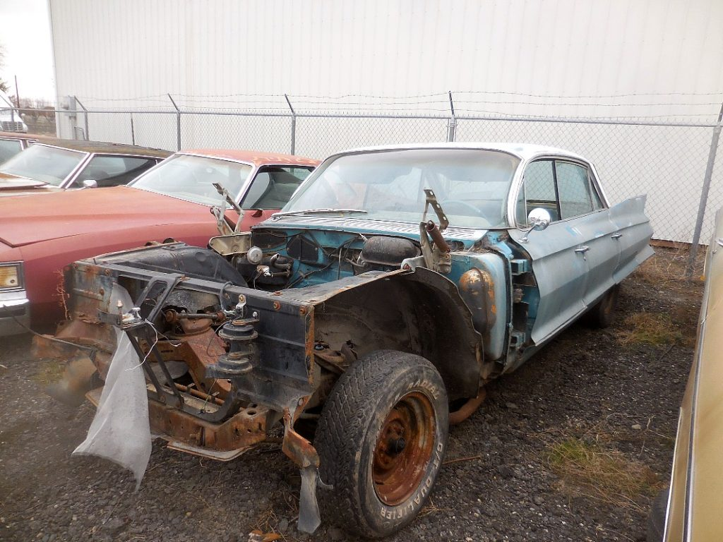 1961 Cadillac 4 dr H/T, no engine, trans or front sheet metal, otherwise complete, nice dash, fender skirts, rear end parts, etc.  Parts car. n-491