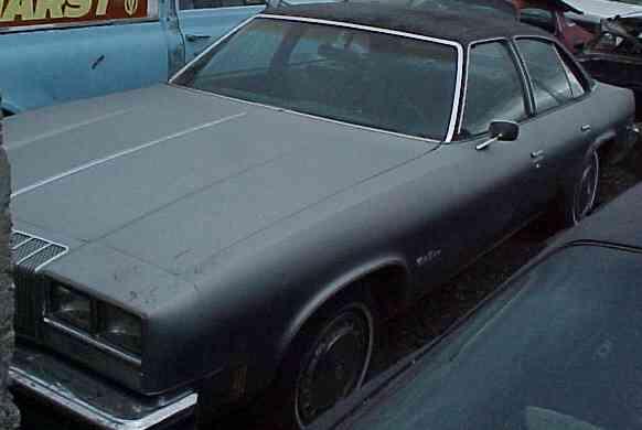1977 Cutlass Supreme - 4 door 260 V-8, automatic, A/C. straight body, clean black interior, runs fair.  $750  n-077