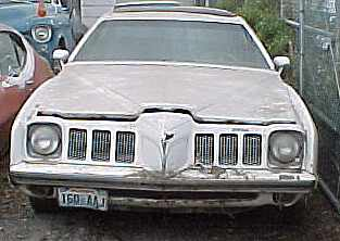 1973 Pontiac Grand Am - 400 engine with the very rare low production 4-speed option, tach, gauges, PW, A/C, tilt, and power sun roof.  Car is straight and running but rear wheel wells are rusted. I am 3rd owner on this one.  $2,800  n-120