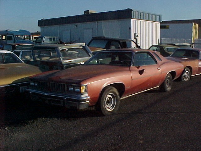 On the lot again! 1976 Lemans 2 door, 350 engine, trans is missing, nearly rust free, has RR quarter damage, Factory A/C, tilt, cruise, nice black interior. $1,200 n-128