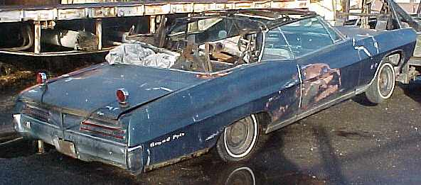 1967 Grand Prix - One of the rarest Pontiac convertibles made. This car came from Florida and is rusted beyond belief but has lots of good parts, has A/C, tilt, buckets, console, P/W, remote mirror, hidden headlights, speed sentinel speedo, etc. All or parts n-158