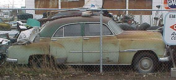 1951 Chev Deluxe - 4 dr. sedan, no engine or trans, nice chrome, body and interior original. $1,350  n-172