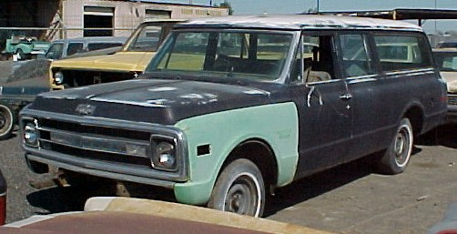1969 Chev 3-door Suburban 1/2 ton, no engine or trans, super straight, excellent rust free body. Hatch and gate, power steering and brakes   $2,500  n-214