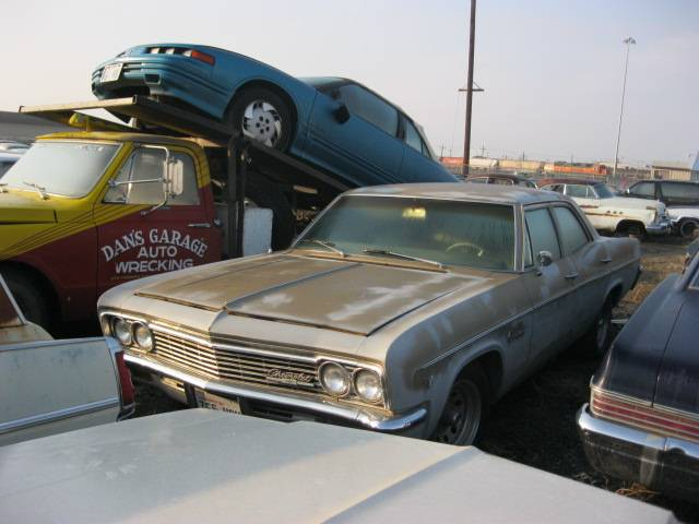 1966 Impala 4 dr sedan  6 cyl. 3 speed on column, straight and original, runs good    $2,250 n-297
