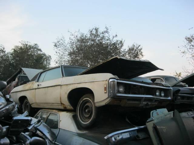 1969 Impala Custom 2 dr Hardtop no engine or trans. has disc brakes, 12 bolt, black interior. Great parts car. n-303