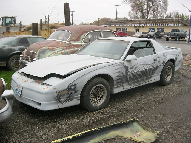 1982 Trans Am 305 5 speed manual runs and drives, super straight, has Recaro style open headrest seats with PMD logos Check out the bizarre Firebird graphics on both sides!    $1,500  n-382