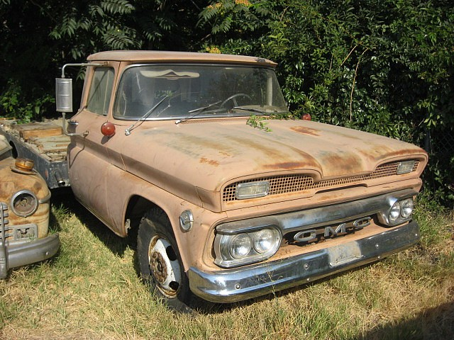 1960 GMC one ton flatbed, w/ dual wheels in rear, 305 V-6, rare Hydramatic trans and ultra rare power brake system. This truck had a Chinook camper mounted when new and is low mileage and very original.  $1,750 n-390