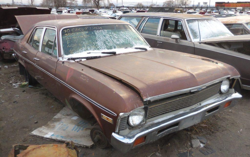 1970 Nova 4 door 350 V-8, Turbo 350 auto, PS straight body w/ rear quarter rust. Parts car only.  n-464