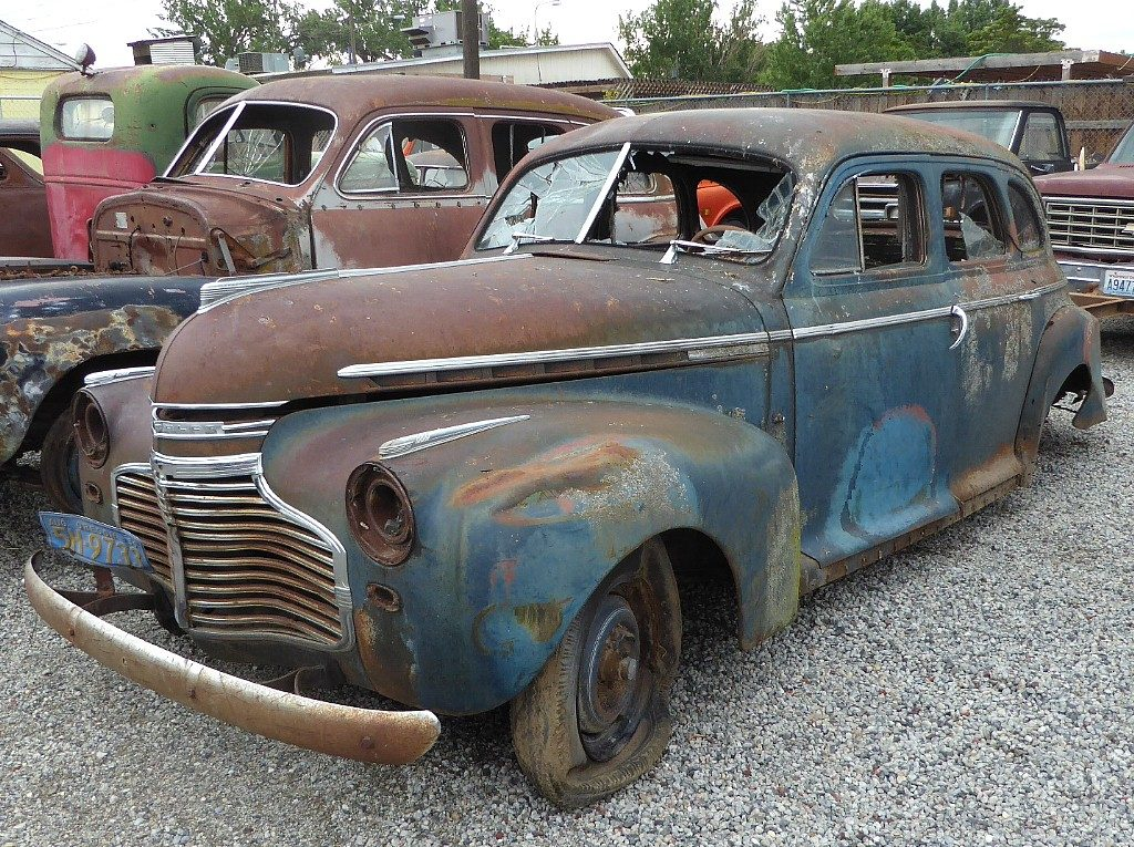 1941 Chev Master deluxe 4 dr sedan , trashed, beat, partially stripped . Pulled out of a farm dump with 1956 license plates still attached. Parts car, rat rod, display? $1,250 n-507