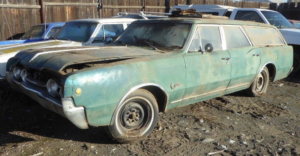 1967 Olds F/85 station wagon, 330 V-8, automatic, power steering and brakes, factory A/C, straight body, not rusty, A/C all complete, ran and drove 25 years ago when purchased $2,450 n-519