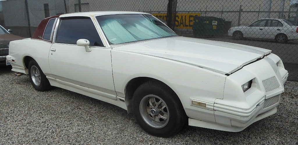 1982 Grand Prix - Has Olds gas 350 Goodwrench replacement engine, dual exhaust with chrome trans Am tips, aftermarket custom nose, ground effects, flares, air dam etc.  Engine runs great, straight body, clean interior very unusual and attractive look for a Grand Prix.  $2,850  n-523