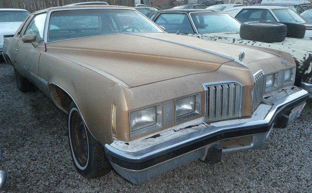 1977 Pontiac Grand Prix 2 dr. Nice straight body, minimal rust, sun faded interior, nice chrome, bumpers, grille etc NO engine or trans.  $1,000 n-537